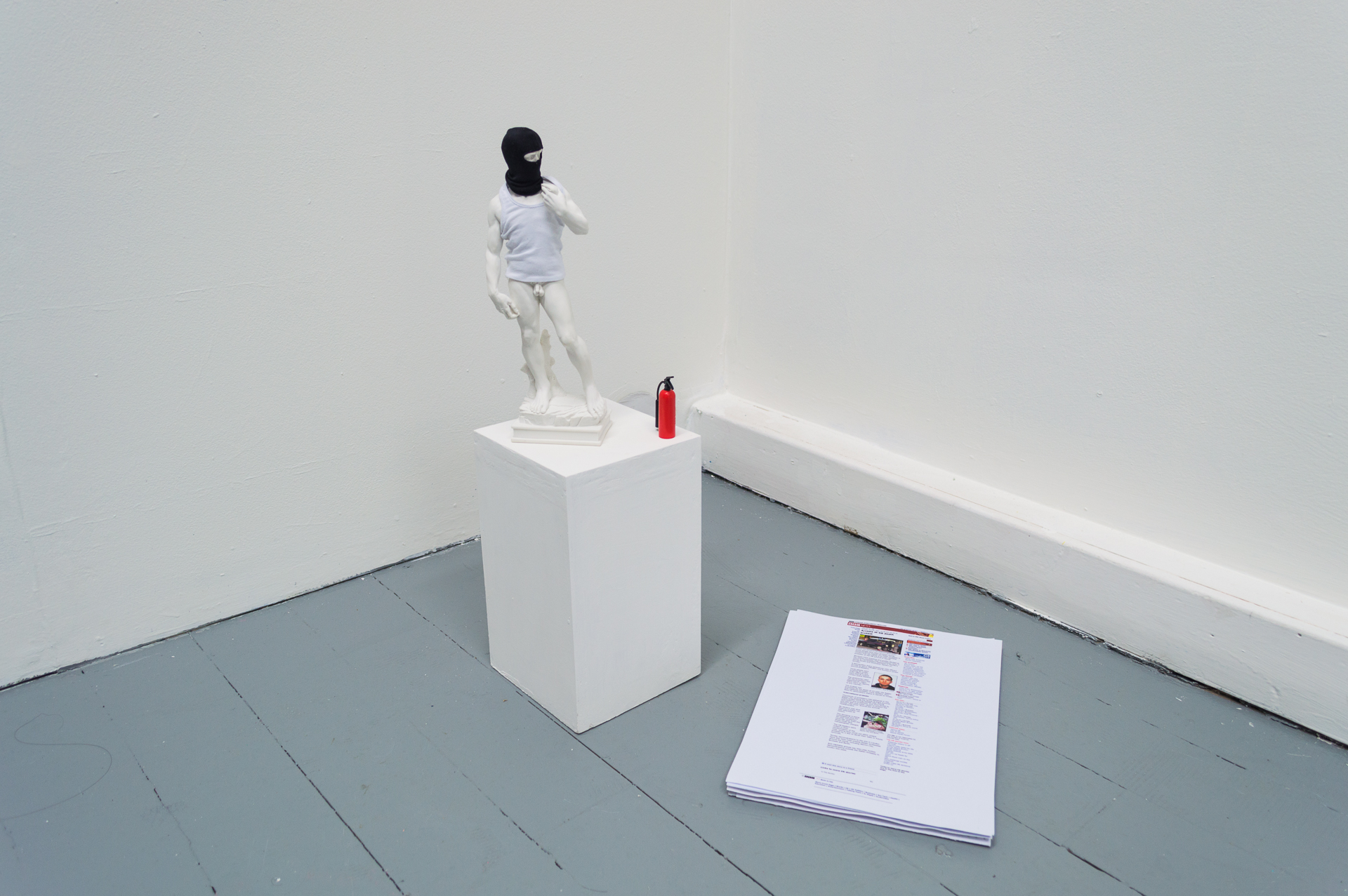 21 JULY 2001, marble powder cast, scale model clothing, fire extinguisher scale model, digital print, plinth. (Statue 45 x 20 cm; plinth 25 x 15 x 15cm), 2017.