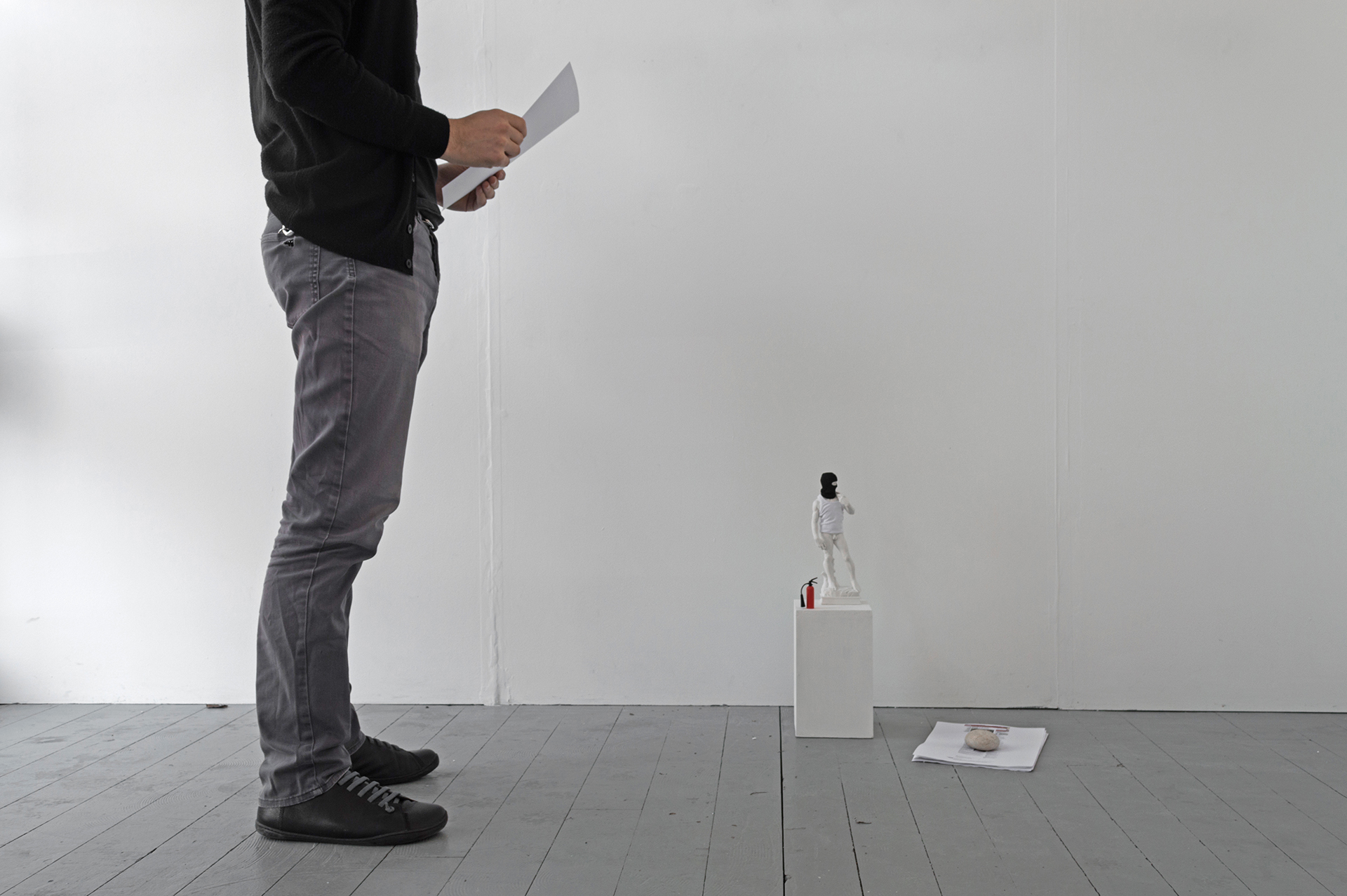 21 JULY 2001, marble powder cast, scale model clothing, fire extinguisher scale model, digital print, plinth. (Statue 45 x 20 cm; plinth 25 x 15 x 15cm), 2017.